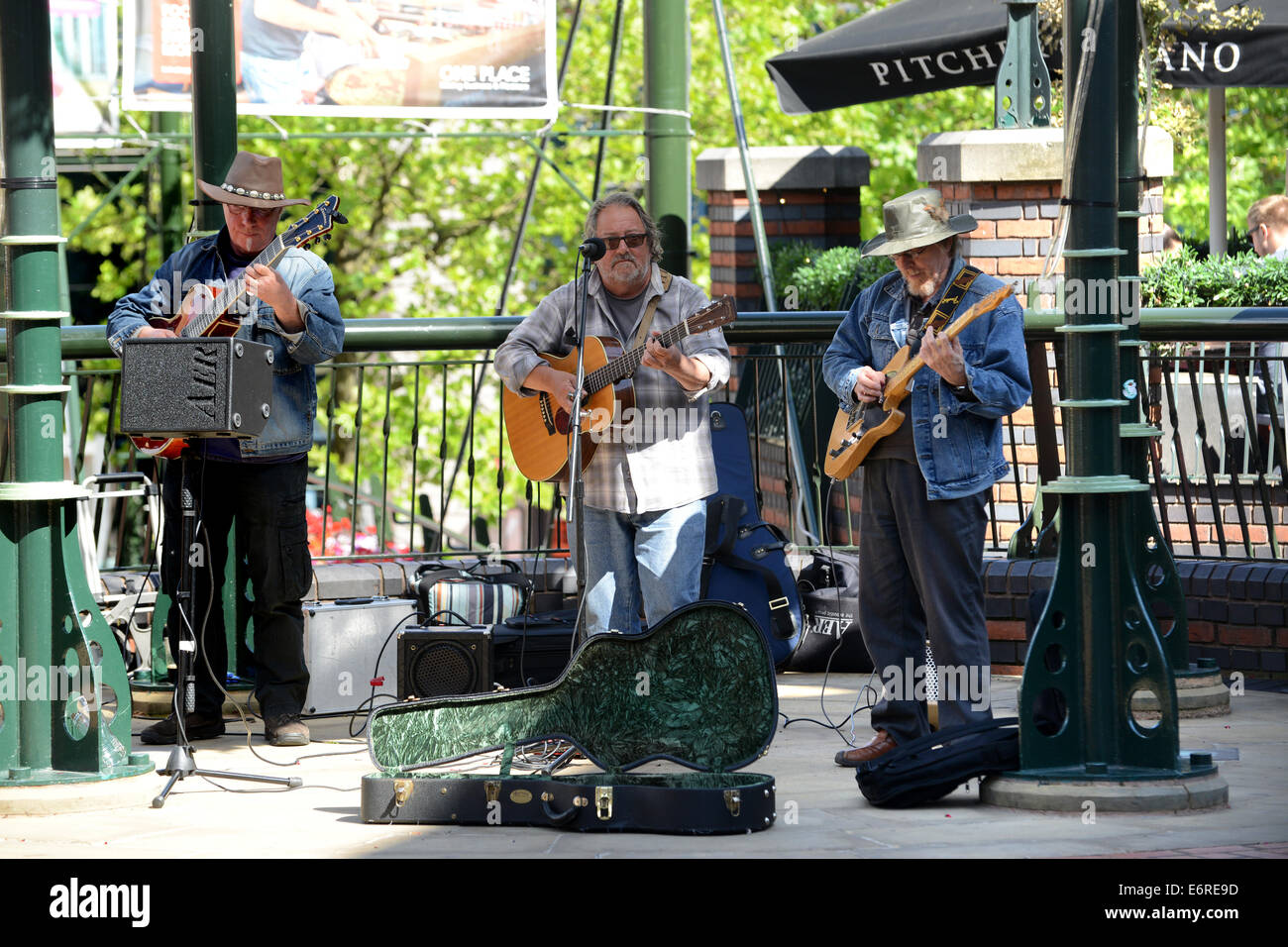 Band musicians busking buskers in Brindley Place Birmingham Uk - Stock Image