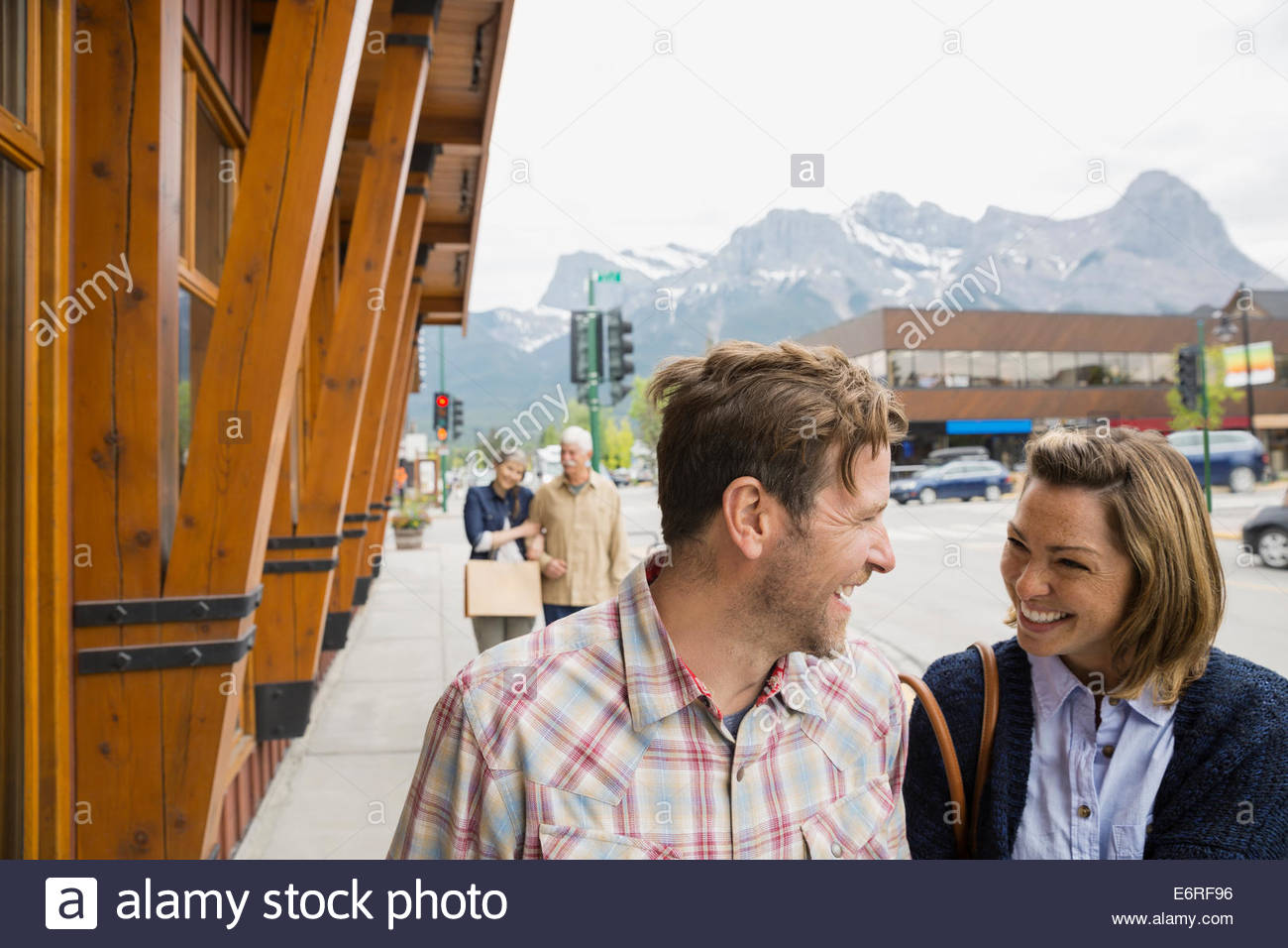 Couple walking on village street Stock Photo