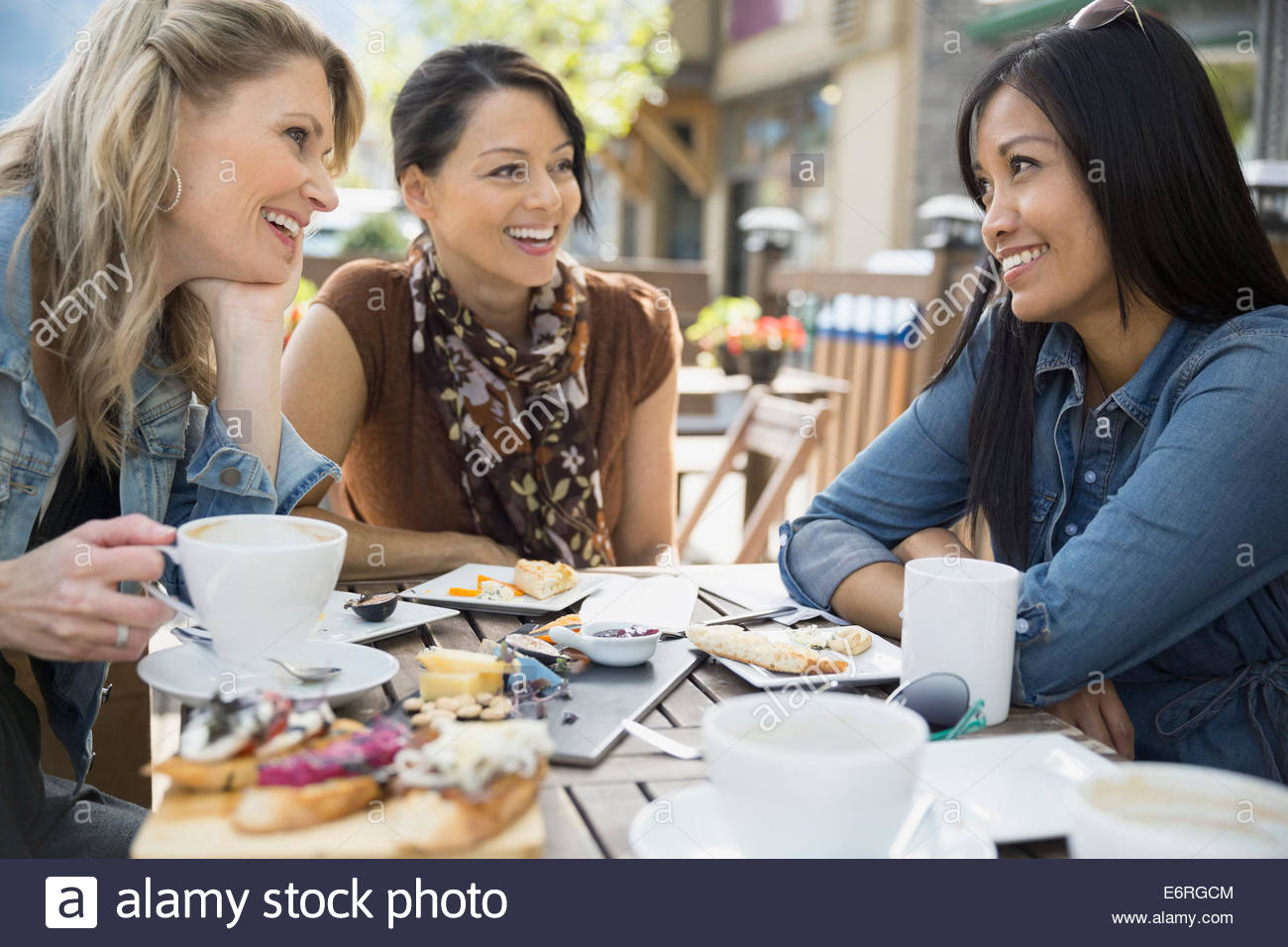 Women eating together in cafe - Stock Image