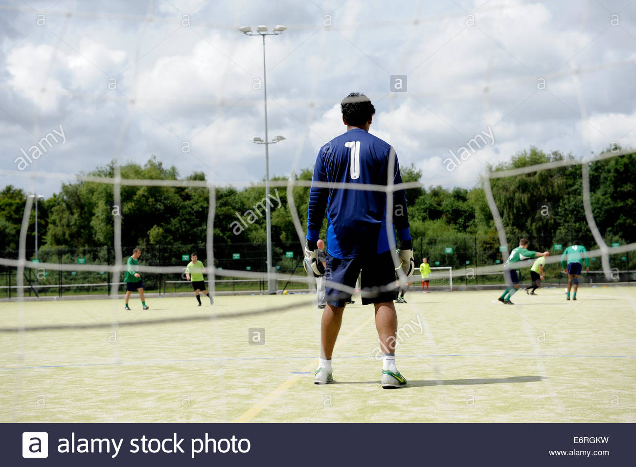 A goalkeepers view of a soccer match - Stock Image