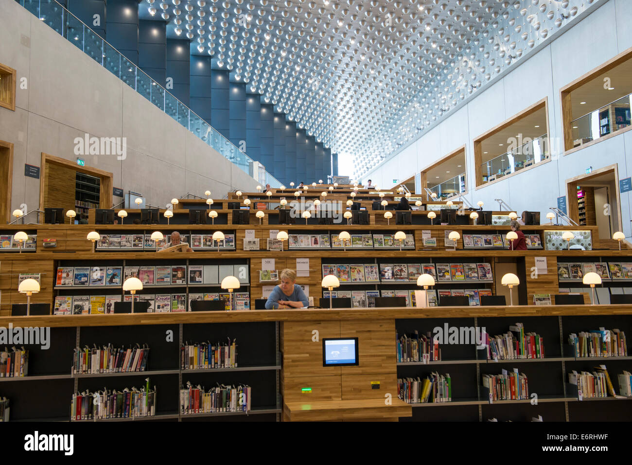 Readers in The Eemhuis in Amersfoort, Netherlands. The building is a cultural centre that combining a library, the - Stock Image