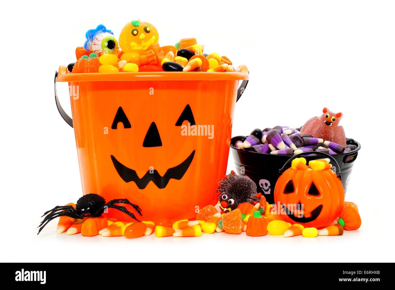 Halloween Jack o Lantern candy bowls with assorted candy - Stock Image