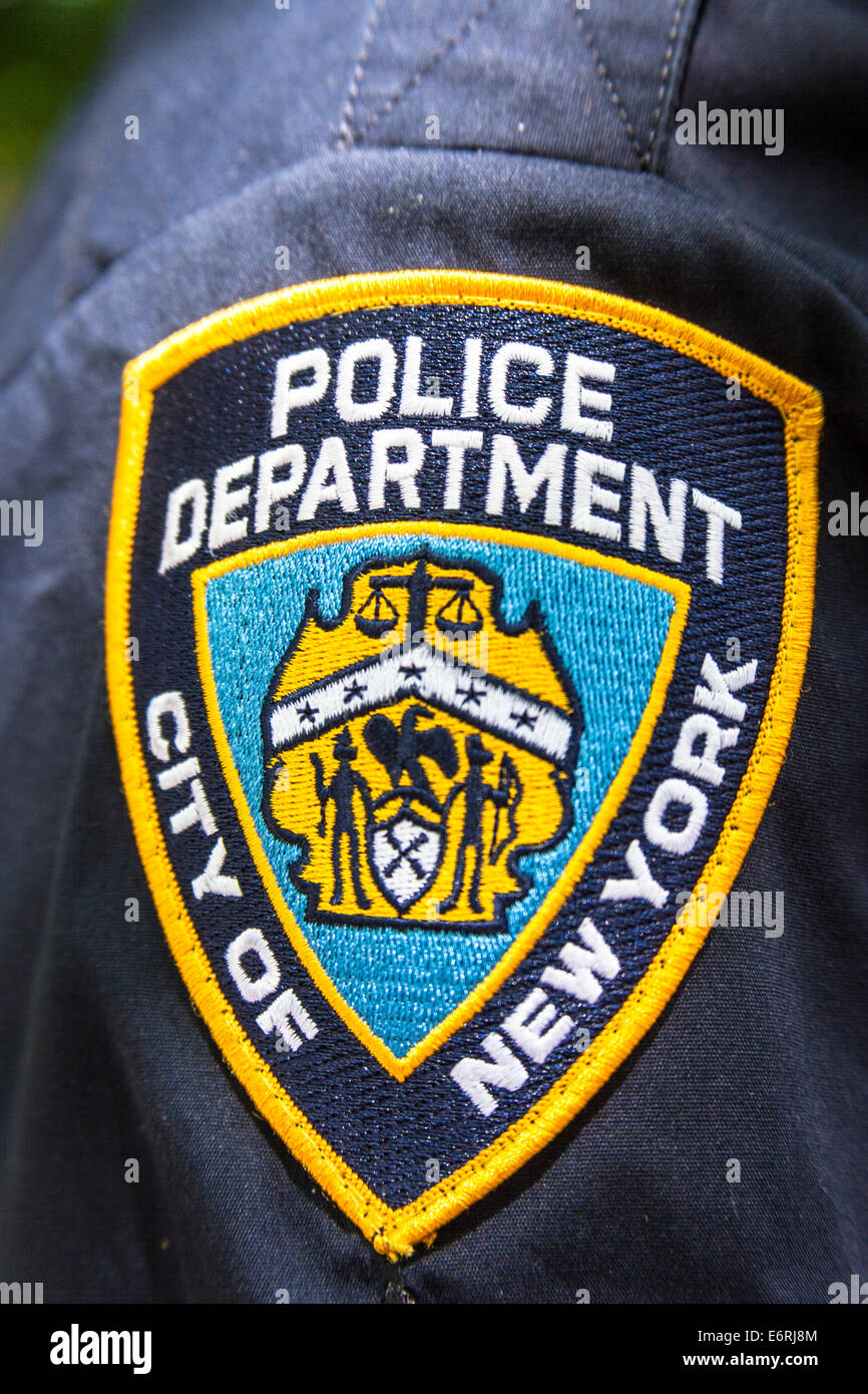 New York Police Department badge on policeman's shirt, NYPD