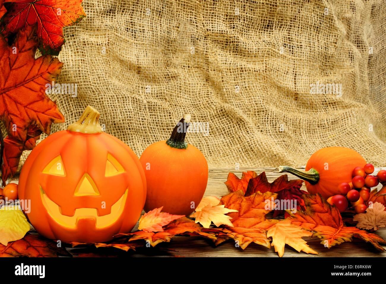 Halloween Jack O Lantern And Leaf Border With Burlap Background Stock Photo Alamy