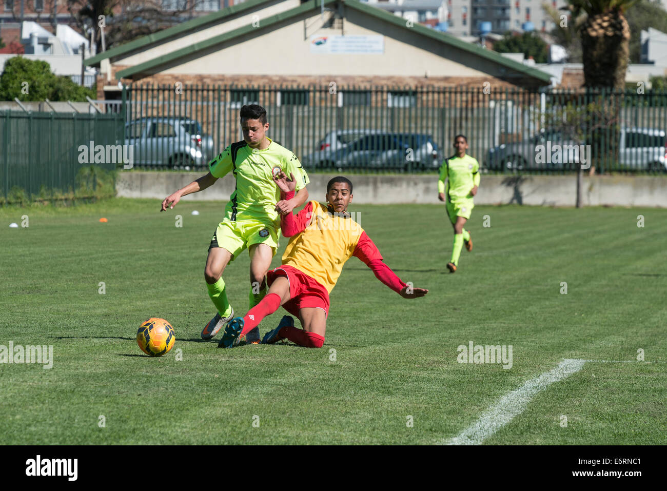 Striker and defender, football match of Under 15 youth teams, Cape Town, South Africa - Stock Image
