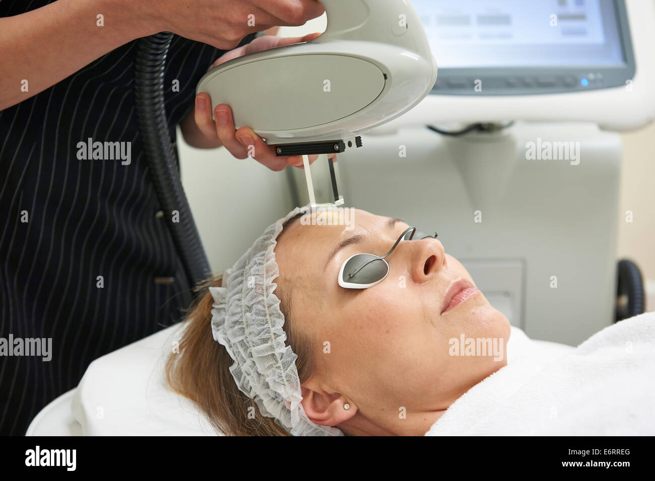 Beautician Carrying Out Intense Pulse Light Treatment - Stock Image