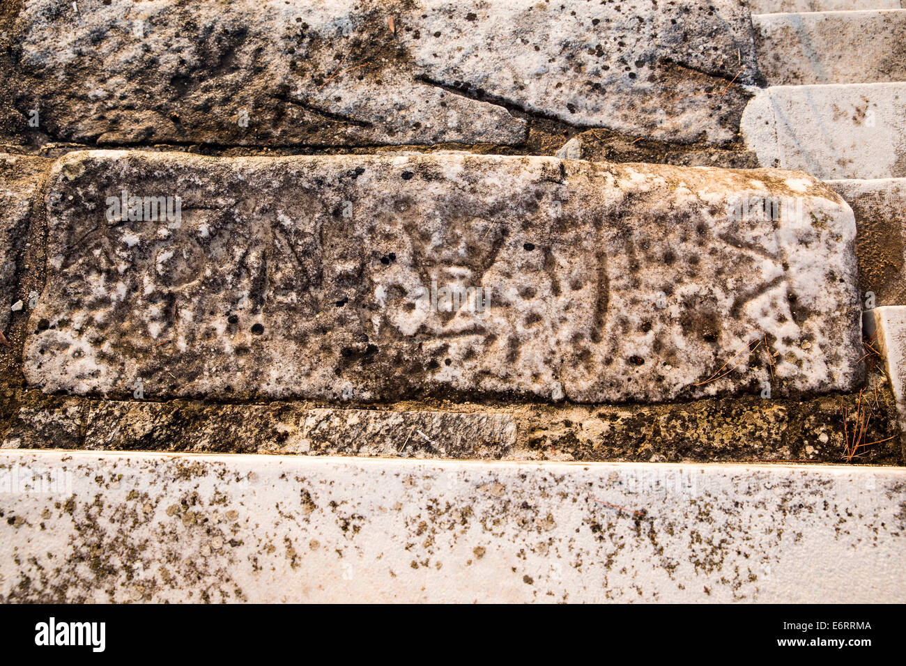 Greek name inscribed on a seat of the amphitheater of Thasos (seat reservation) - Stock Image