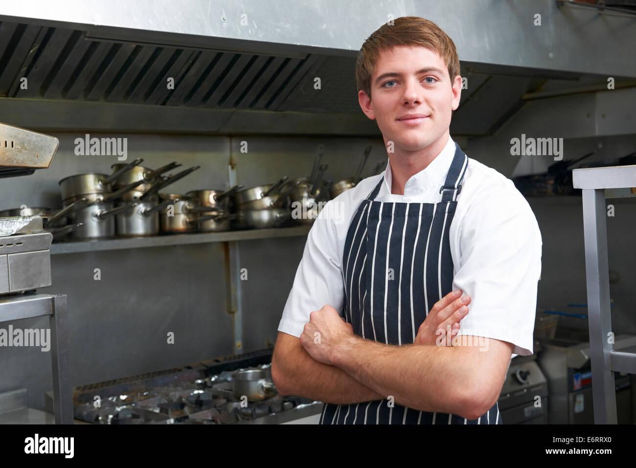 Portrait Of Chef In Restaurant Kitchen - Stock Image