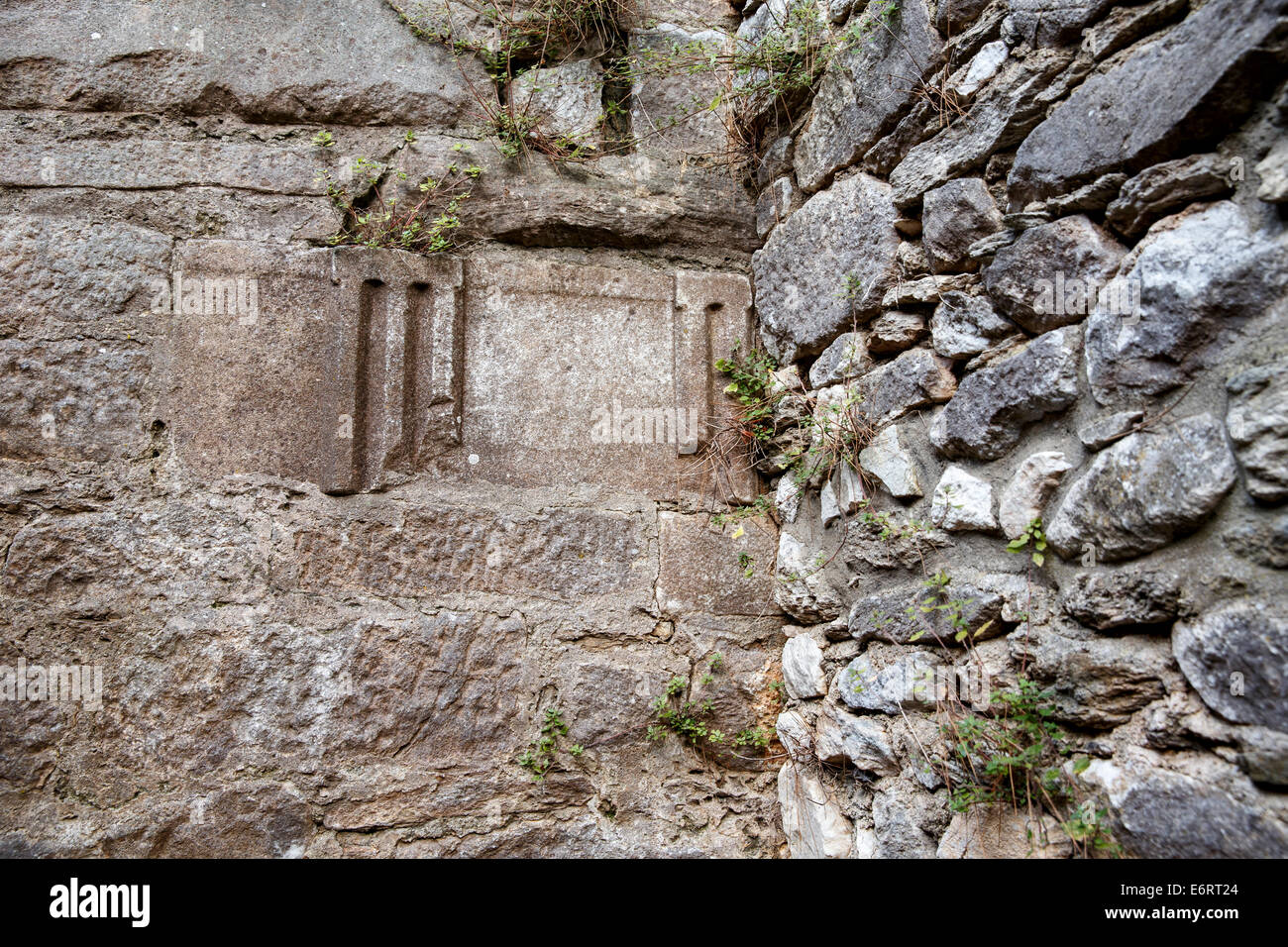 Reused piece of antique greek masonry in the wall of the medieval fortress on the akropolis of Limenas, Thasos. - Stock Image