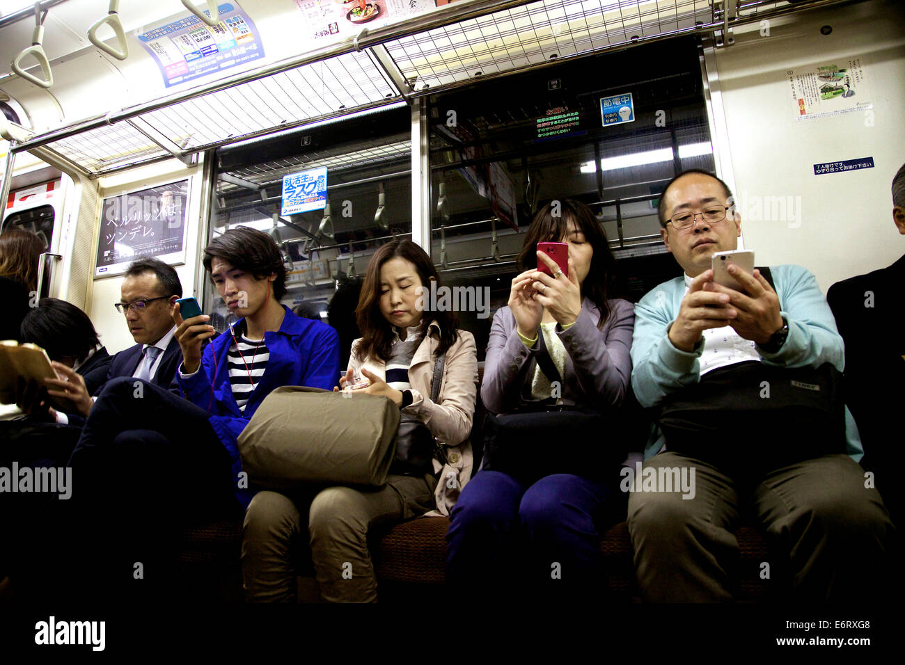 People, commuters traveling on subway train, with mobile ...