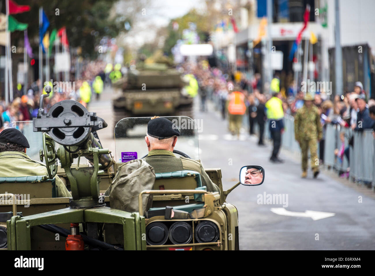 .A Light Cavalry Reconnaissance Land Rover follows the Centurian Mk5 Battle Tank in the parade down Macquarie Street, - Stock Image