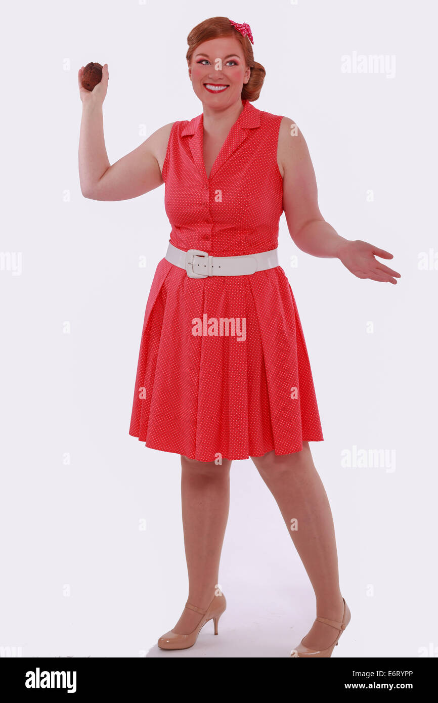 c88eec667 Red-haired woman in red dress 60 years Style and obesity, poses with a