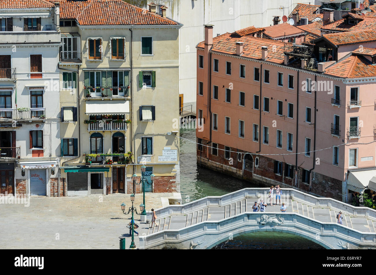 Traditional Venetian buildings facing the grand canal with shuttered windows and doors. - Stock Image