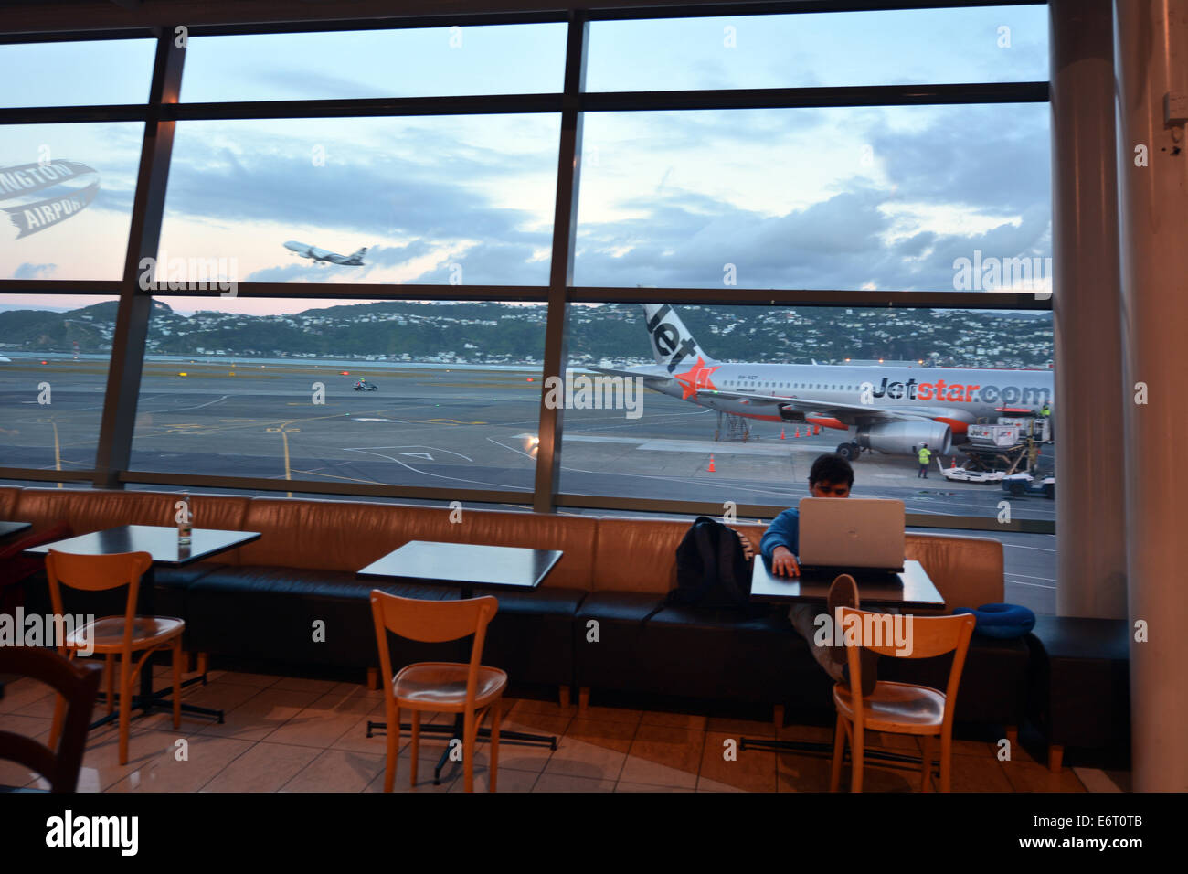 WELLINGTON - AUG 21 2014:Passenger wait at Wellington International Airport. It is the second busiest airport in - Stock Image