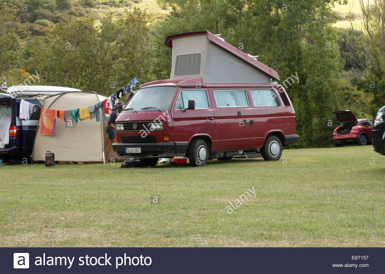 VW Campervan on Campsite, Osmington Mills, Dorset, England, UK - Stock Image