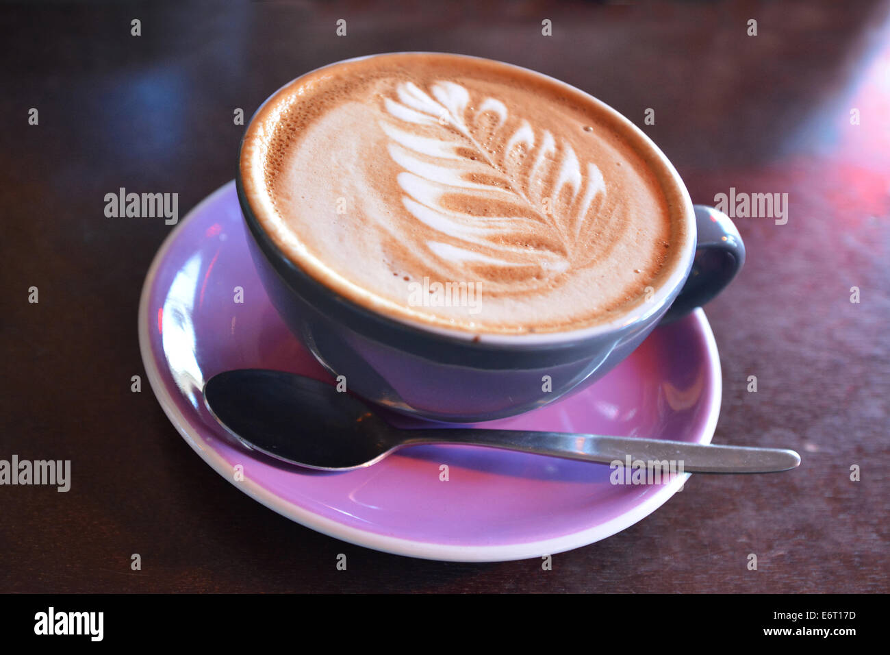 Flat white coffee decorated with the New Zealand iconic symbol the silver fern on it. Copy space - Stock Image