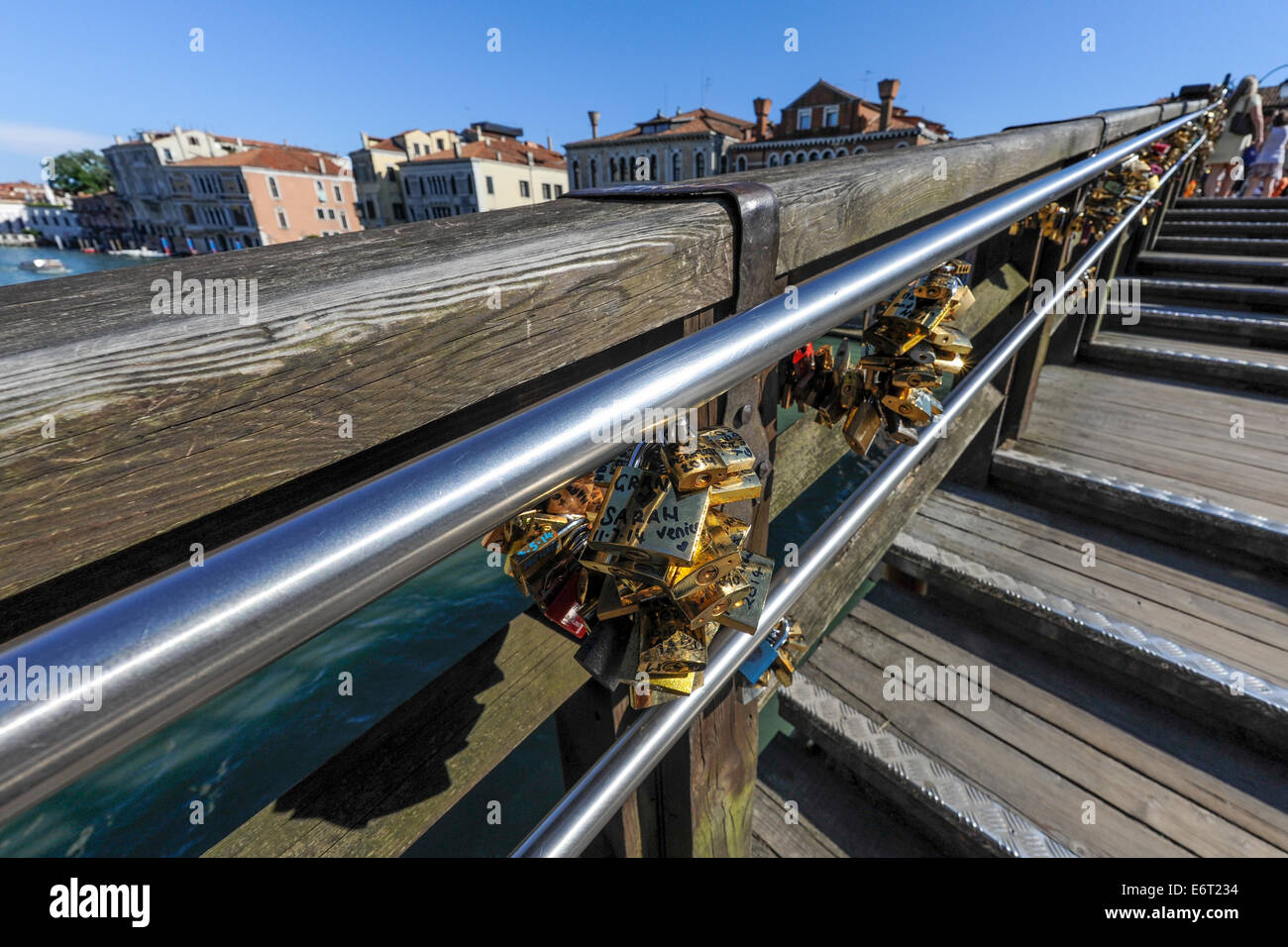 Love padlocks on the Ponte di Academia or the academia bridge which spans the Grand canal in Venice, Italy. - Stock Image