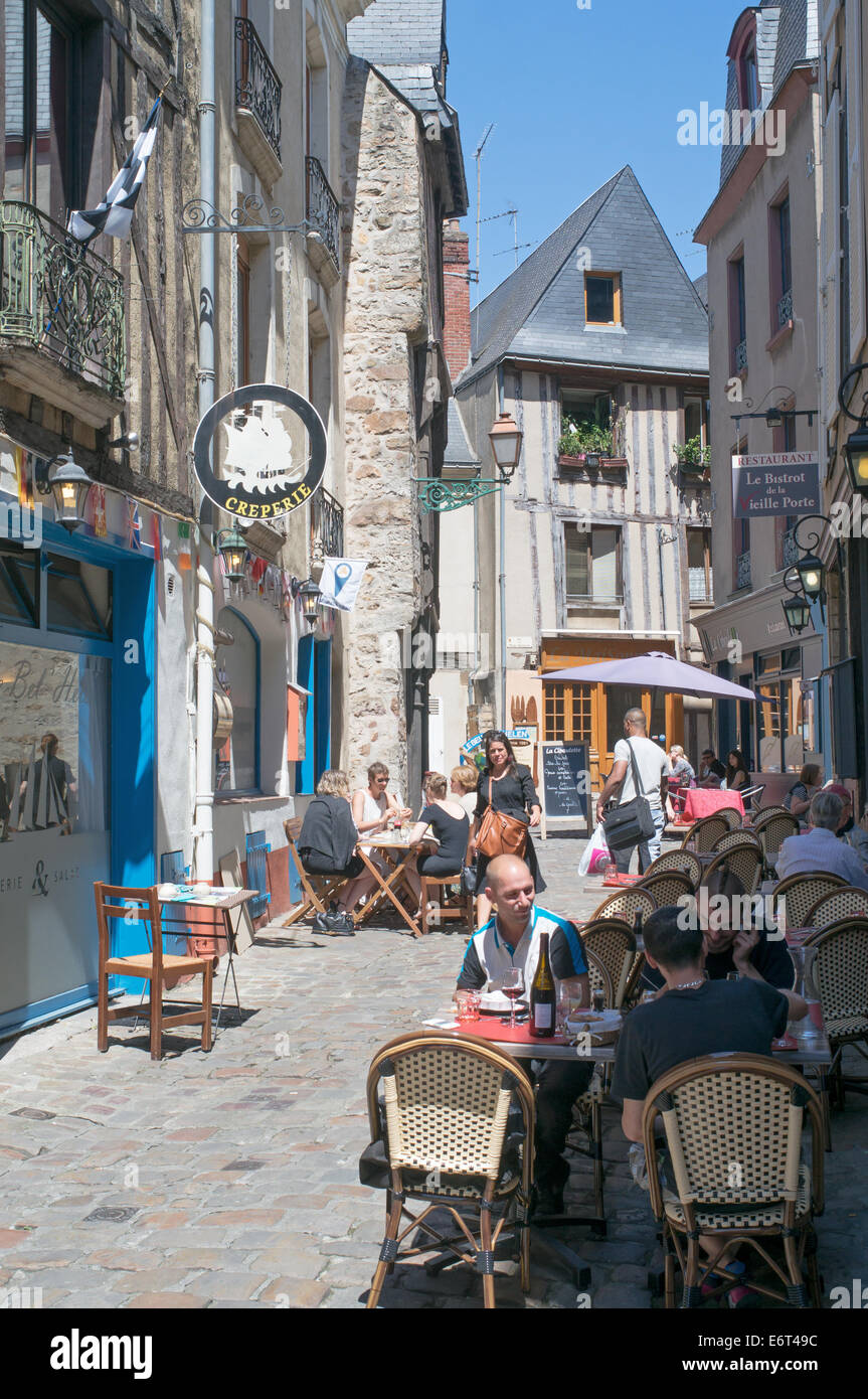 People sitting at restaurant tables old town Le Mans, France, Europe Stock Photo