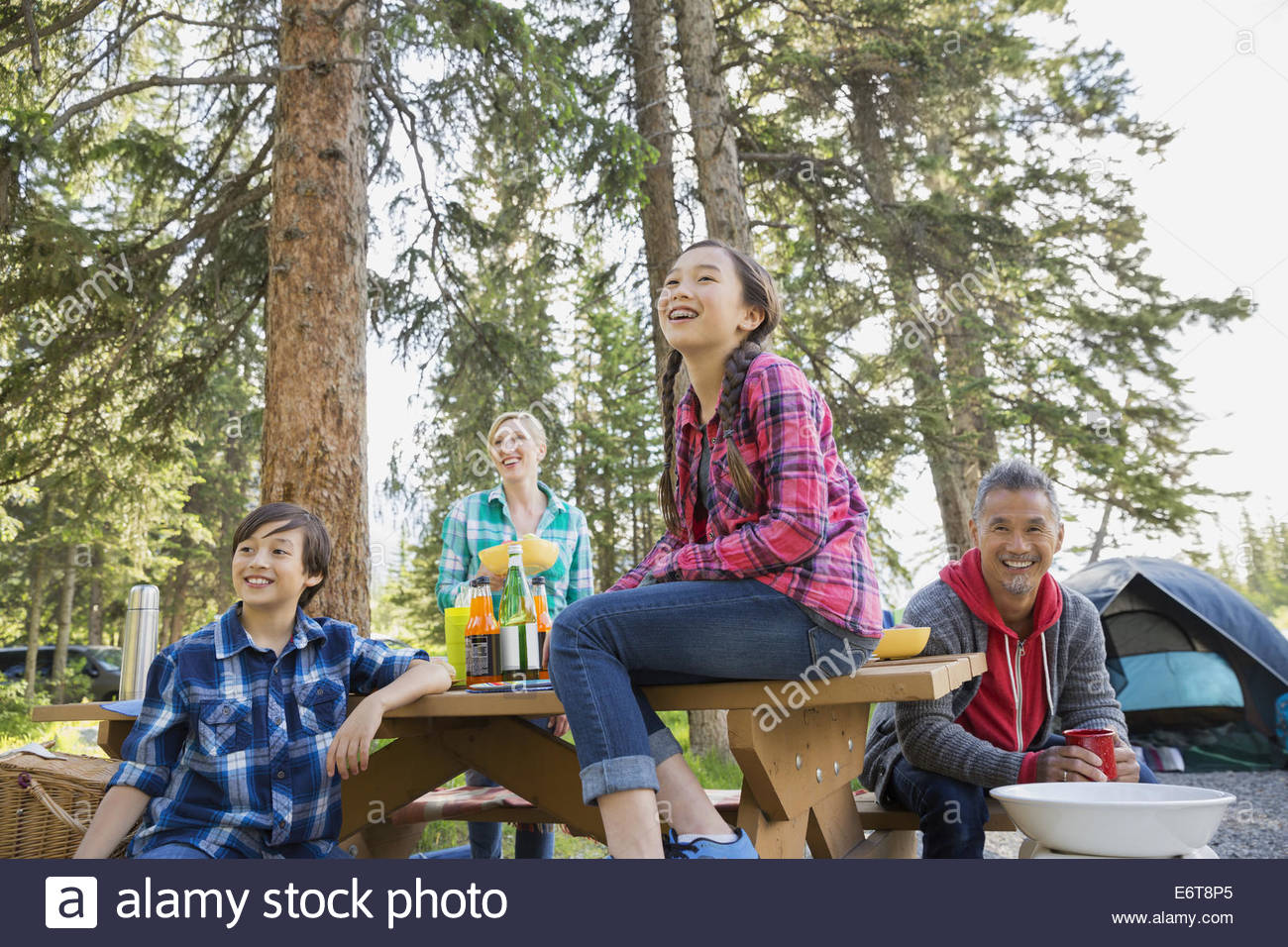 Family eating together at campsite - Stock Image