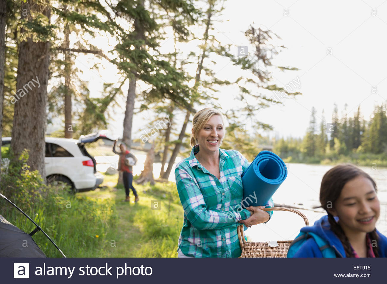 Mother and daughter walking by campsite - Stock Image