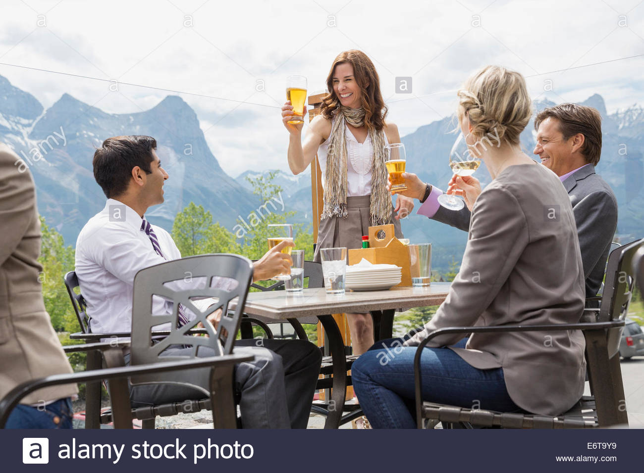 Business people toasting each other at networking event - Stock Image