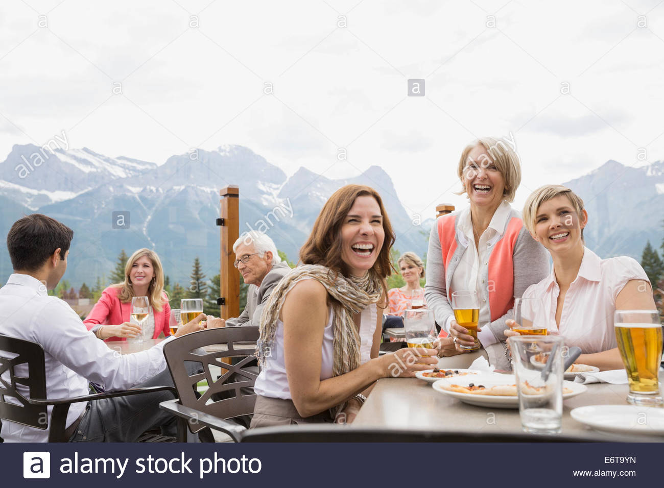 Business people laughing at networking event - Stock Image