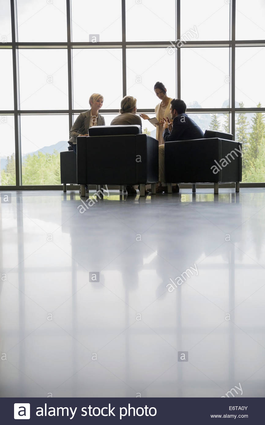 Business people meeting in office lobby - Stock Image