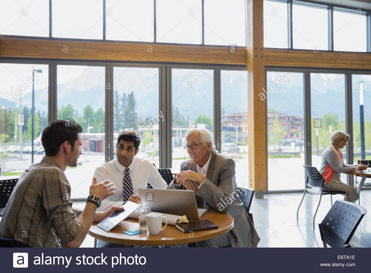 Businessmen talking in meeting - Stock Image