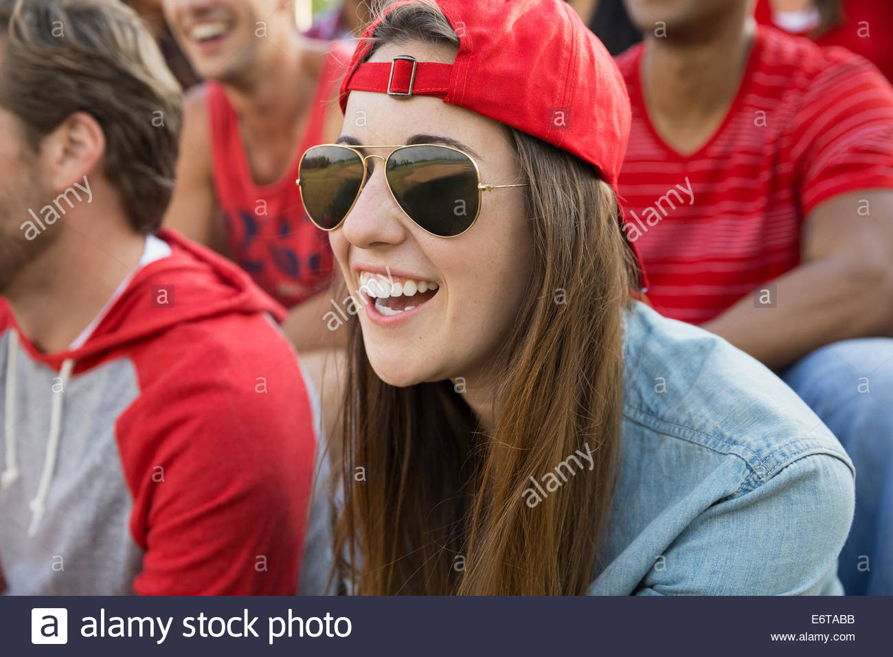 Woman laughing at sporting event - Stock Image