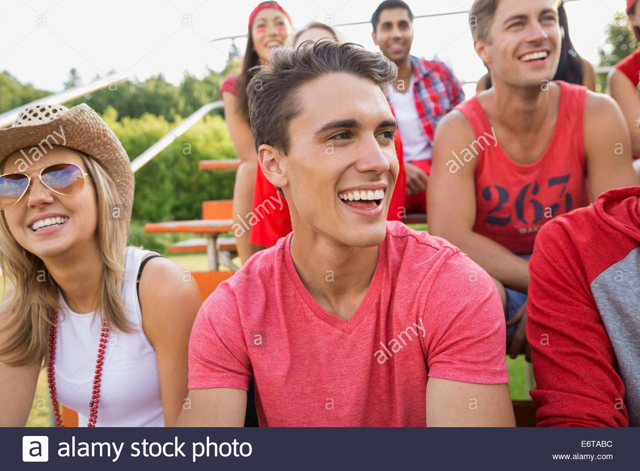 Man laughing at sporting event - Stock Image