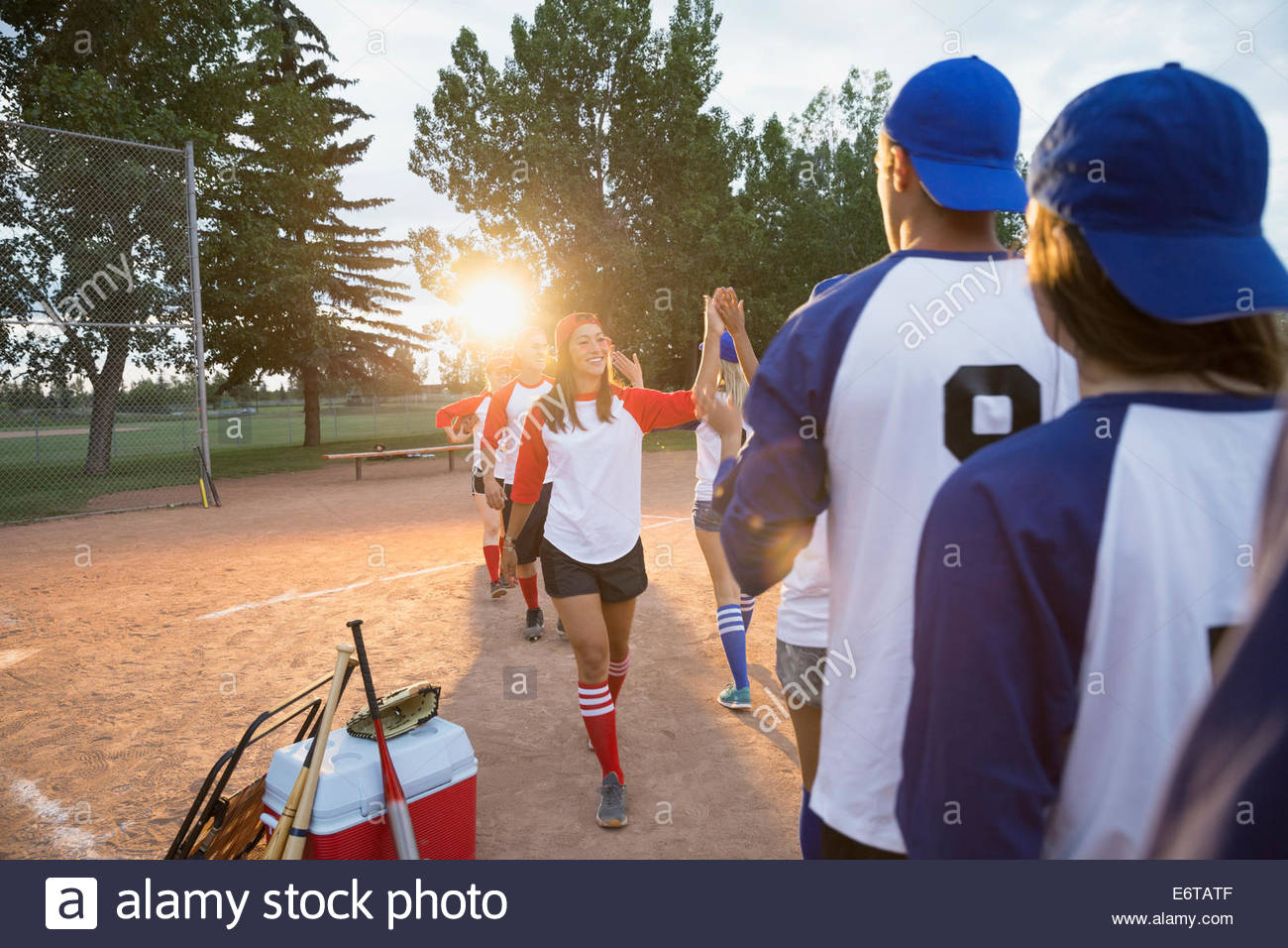 Baseball teams high filing on field - Stock Image