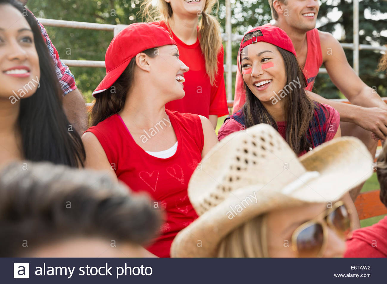 Women talking at sporting event - Stock Image