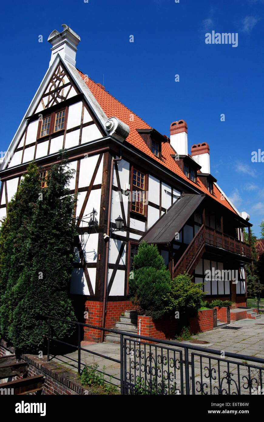 GDANSK, POLAND:  Half-timber house with wooden trim and exterior staircase and balcony - Stock Image