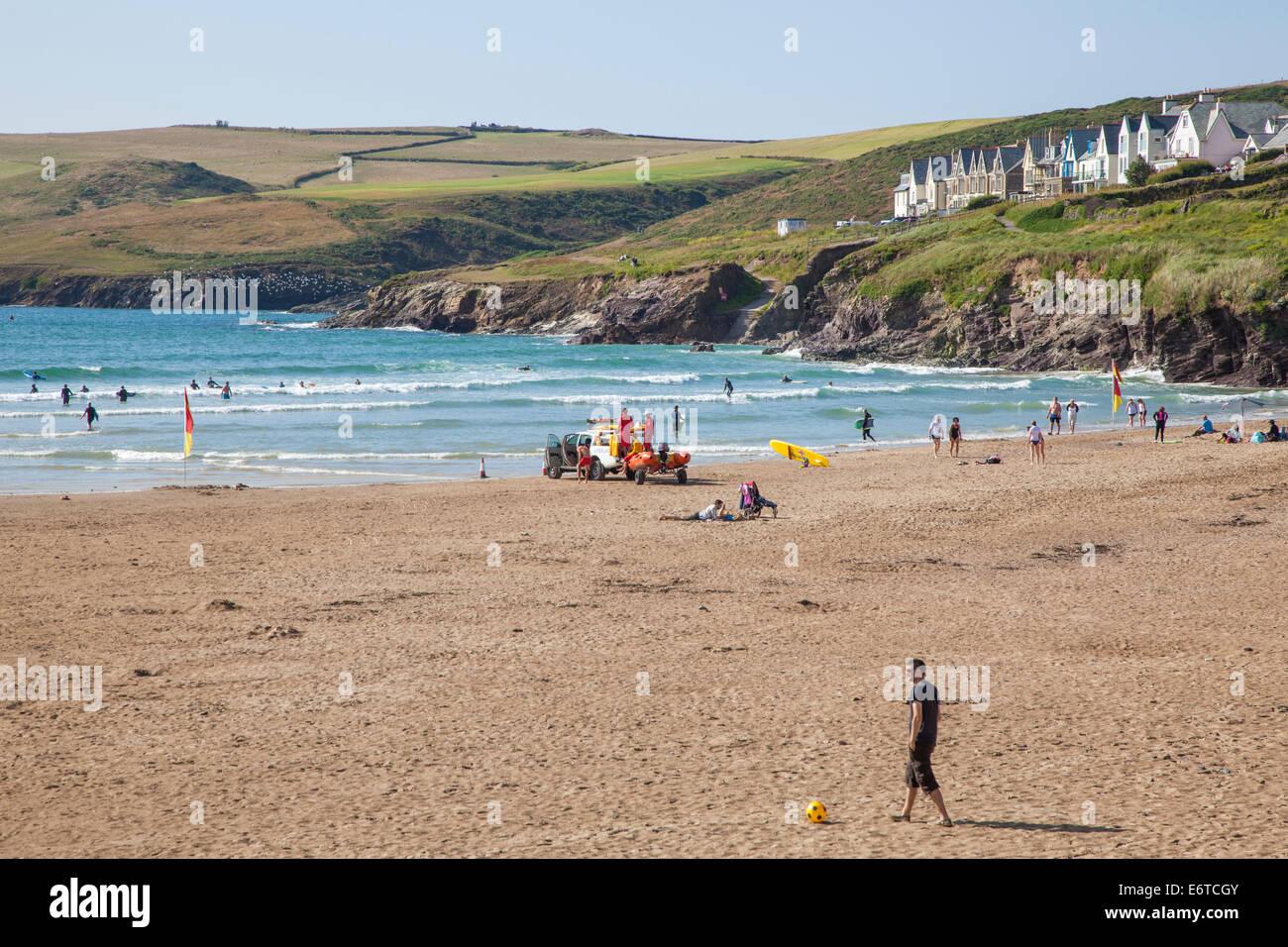 The beach and sea at Polzeath seaside resort, Cornwall, England, UK - Stock Image