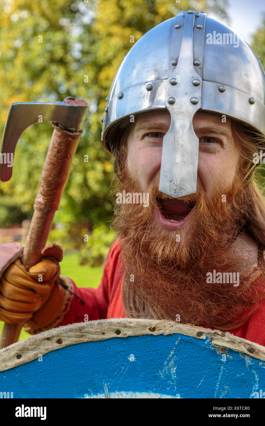 Re-enactment actor and Viking enthusiast playing the part of a Viking warrior at a battle re-enactment, Largs, Viking - Stock Image