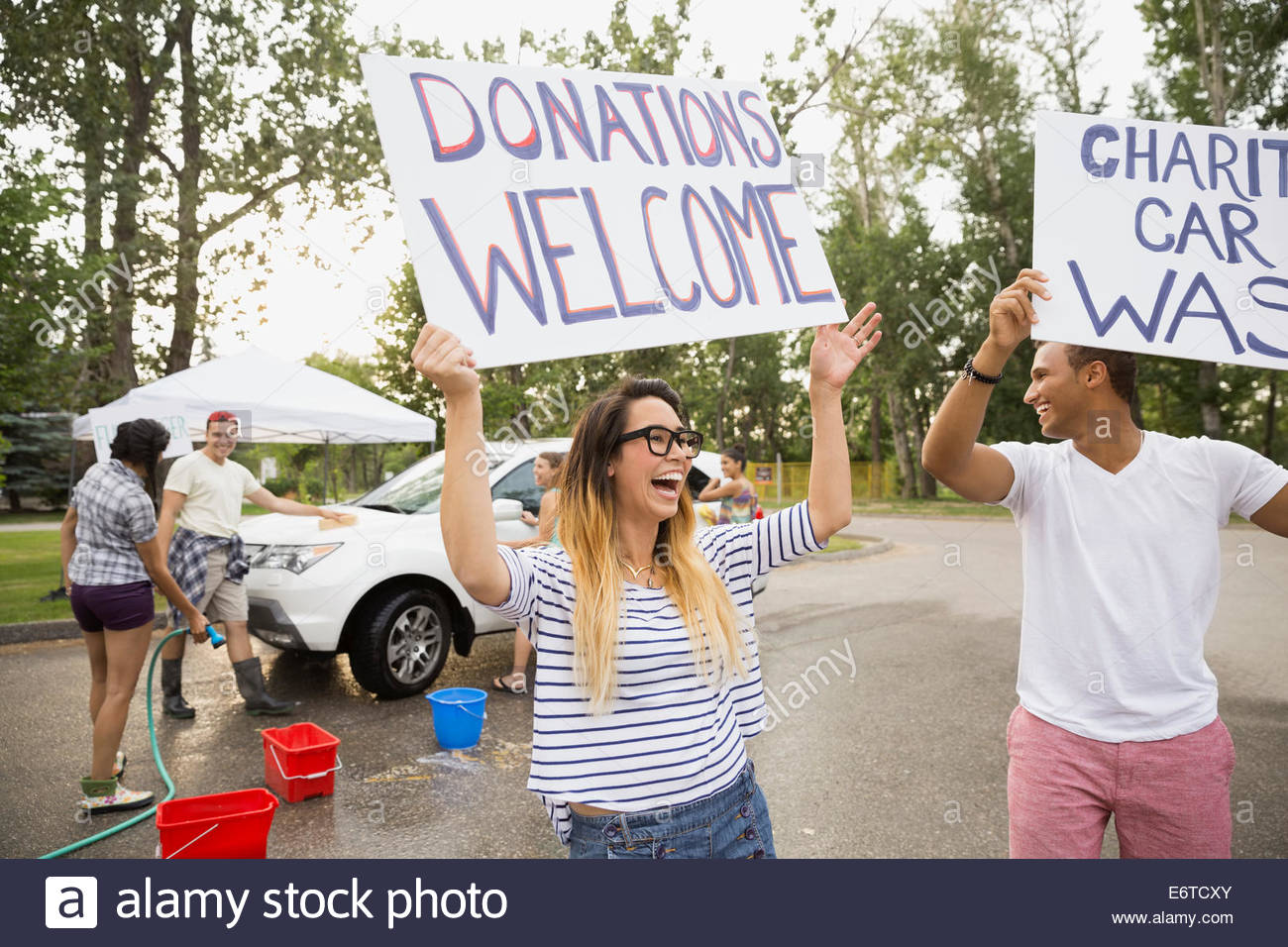 Car wash signs stock photos car wash signs stock images alamy enthusiastic volunteers waving charity car wash signs stock image solutioingenieria Images