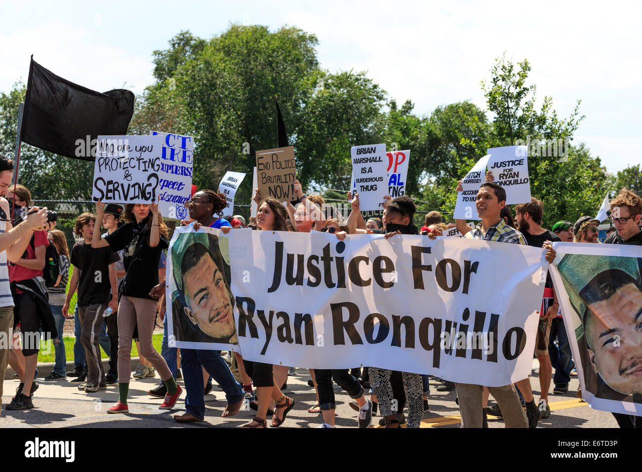 Denver, Colorado, USA. 30th Aug, 2014. Activists march for justice in solidarity with Ferguson to support the family - Stock Image