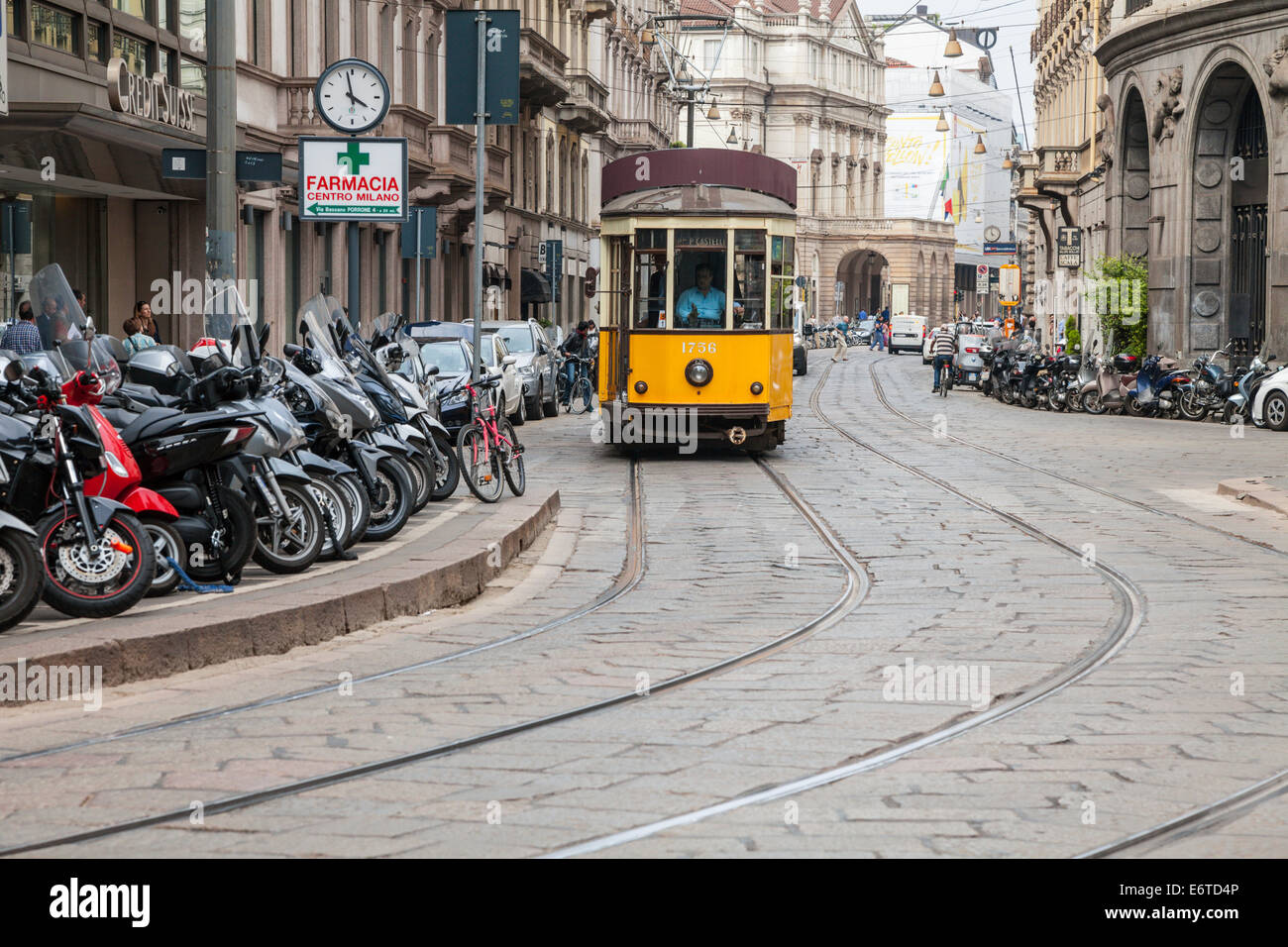 Orange tram on the streets of Milan, Italy - Stock Image