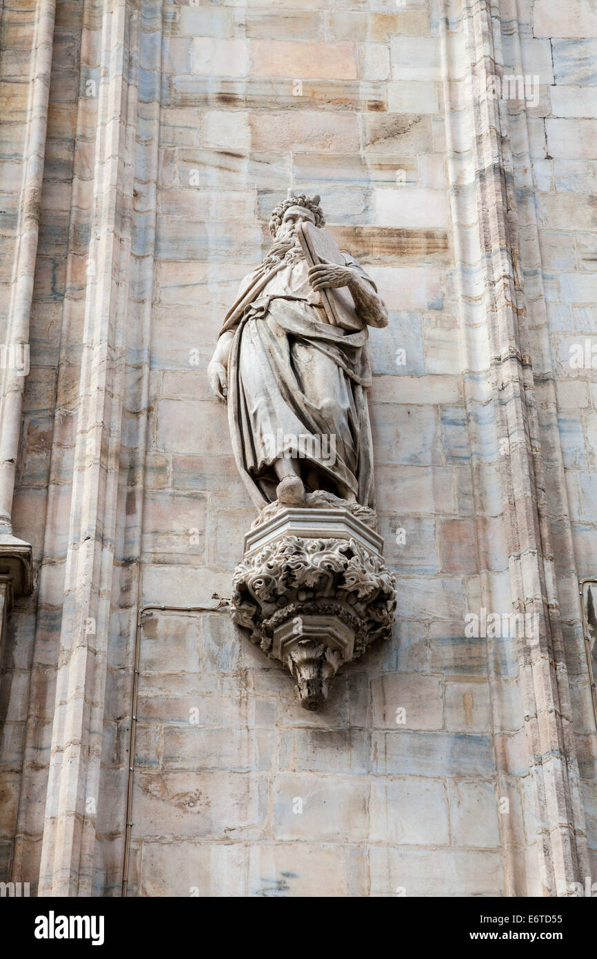 Statue on the exterior of Milan Duomo - cathedral - Milan, Italy - Stock Image