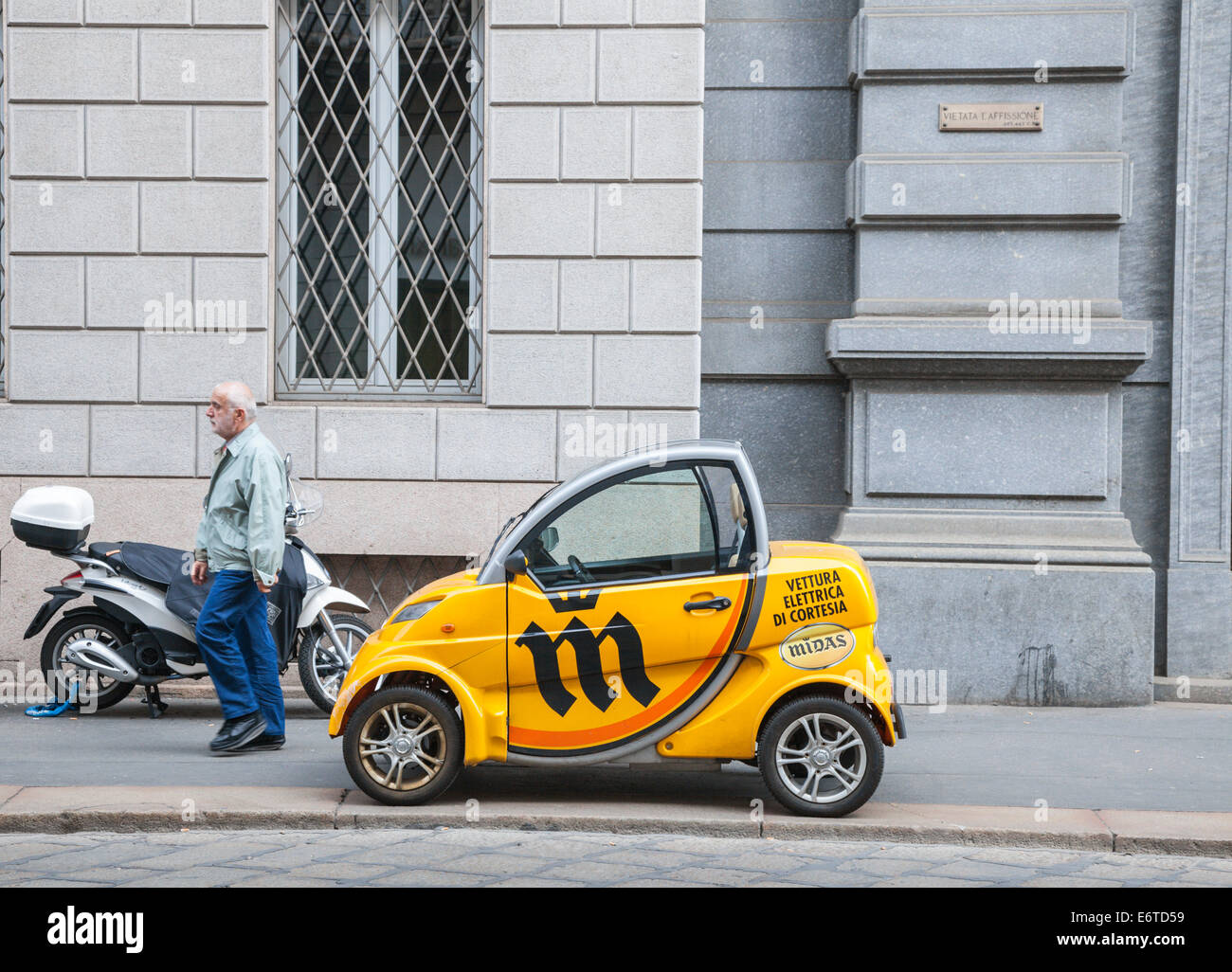 Tiny electric car in Milan, Italy - Stock Image