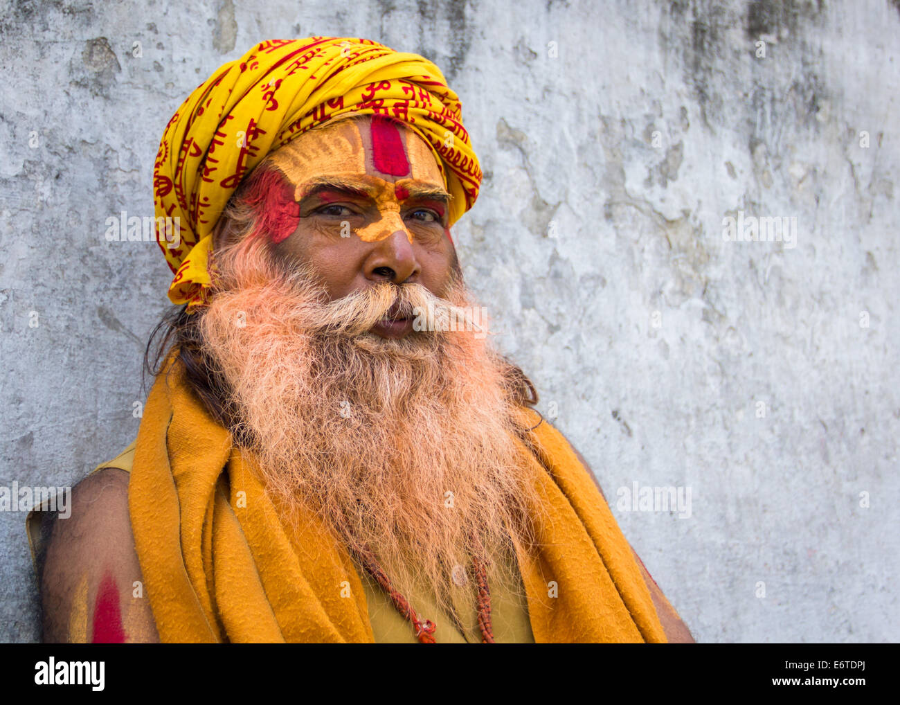 A Hindu sadhu (holy man), wearing traditional paint and a headscarf, at the Hindu temples of Pashupatinath, Kathmandu, - Stock Image