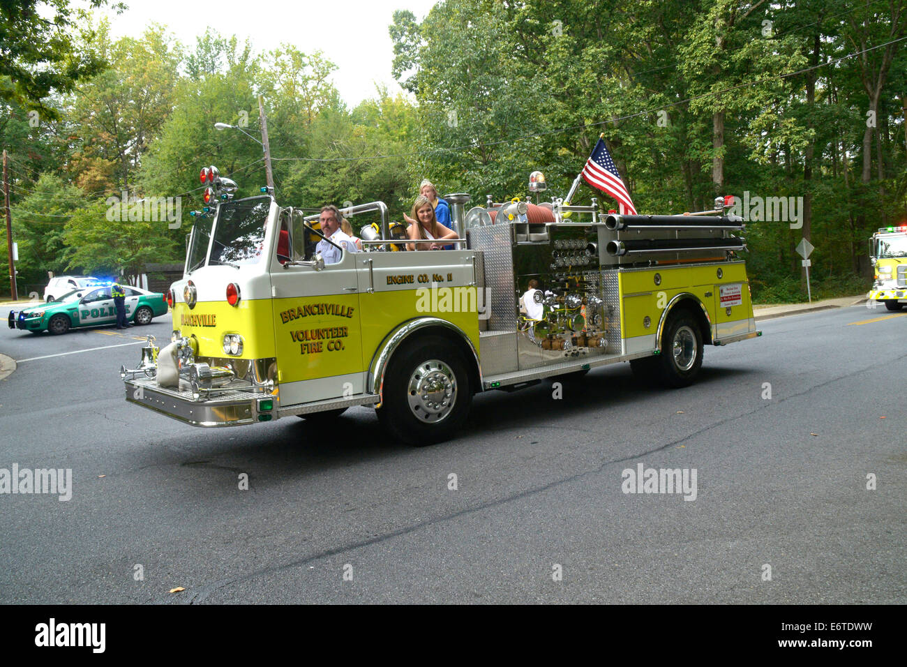 Jr Miss Fire Prevention in a fire truck in a fire department parade in Greenbelt, Maryland - Stock Image
