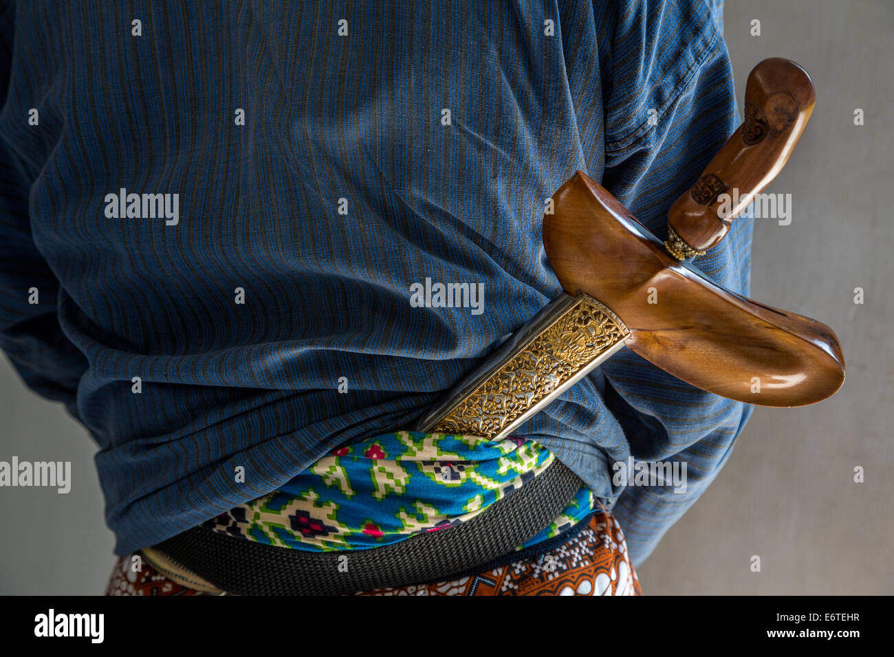 Yogyakarta, Java, Indonesia.  Sultan's Palace Guard with Kris (Traditional Javanese Dagger) Tucked into Waistband. - Stock Image
