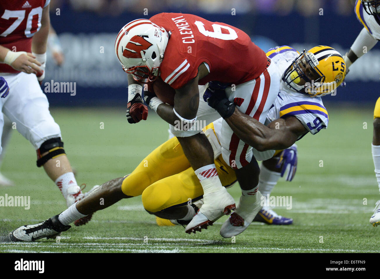 Houston, Texas, USA. 30th Aug, 2014. Wisconsin Badgers running back Corey Clement (6) is tackled by LSU Tigers defensive - Stock Image