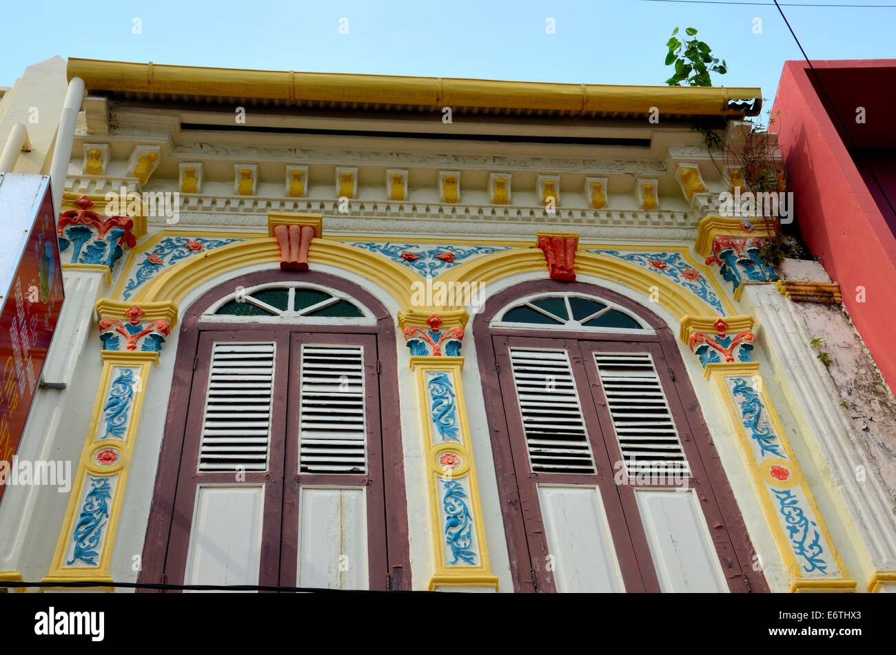 Ornate decorated shophouse windows shutters and wall in Malacca Malaysia - Stock Image