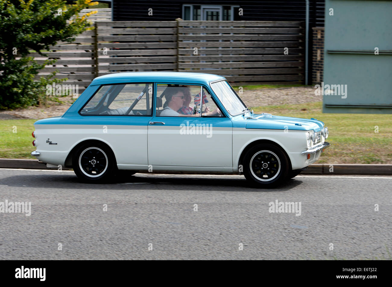 Hillman Imp Super car on the Fosse Way road, Warwickshire, UK - Stock Image