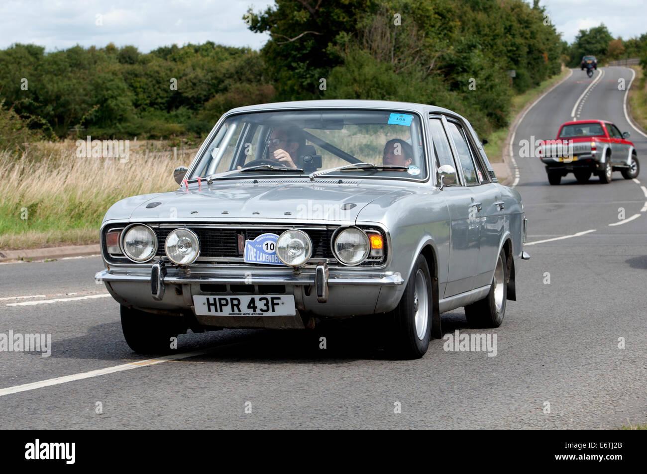 Ford Cortina car on the Fosse Way road, Warwickshire, UK - Stock Image