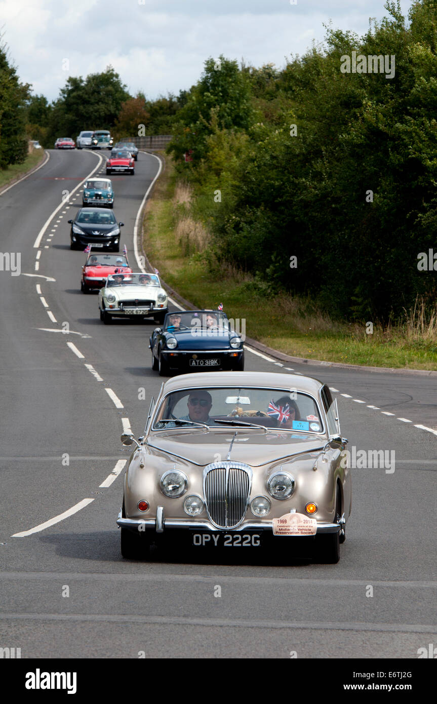 A convoy of cars in the Coventry Festival of Motoring Historic Vehicle Run. Stock Photo