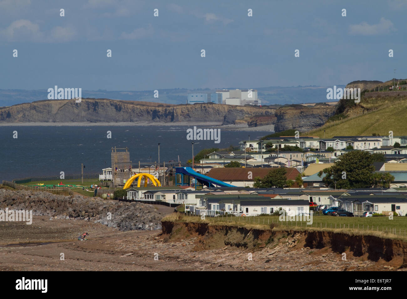 Caravan Park with Hinkley Point Nuclear Power Station in background. Bristol Channel. Somerset. UK - Stock Image