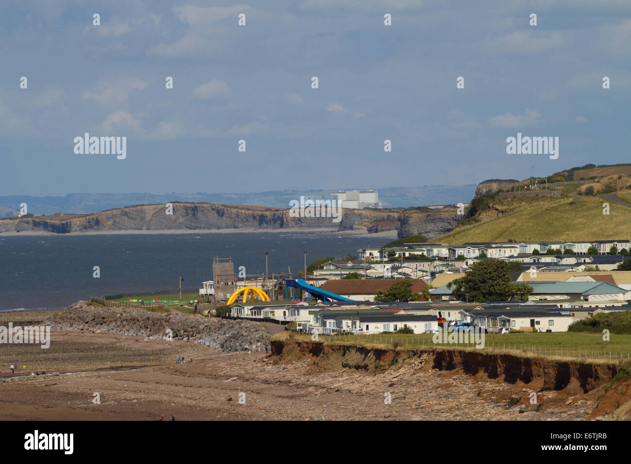 Caravan park with Hinkley Point Nuclear power station in background. Bristol Channel. Somerset - Stock Image